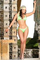 model Vivianna in lime green swimsuit